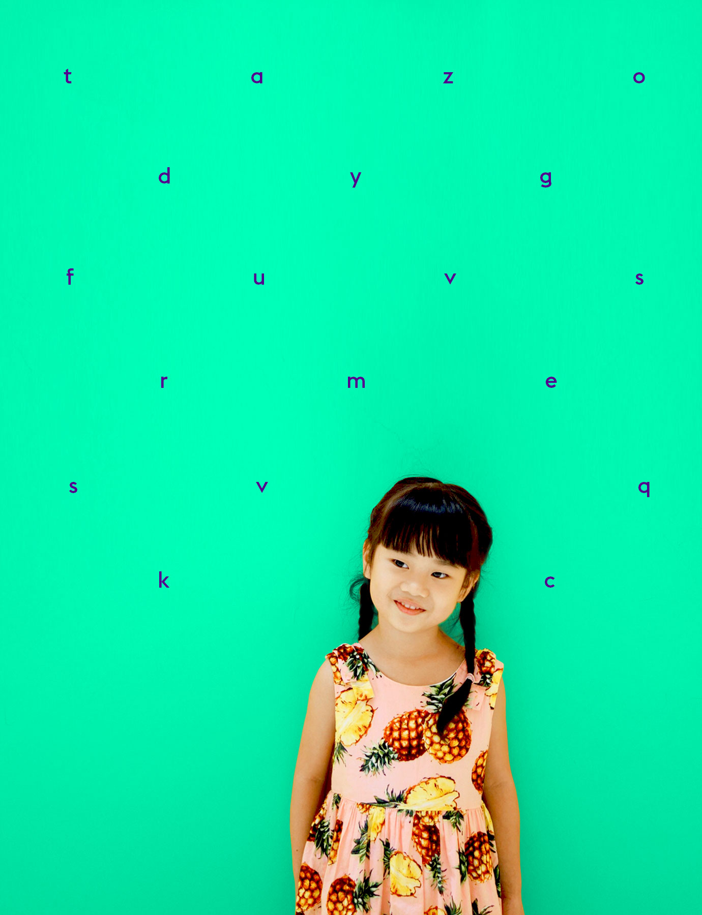 asian girl against a wall with letters on it