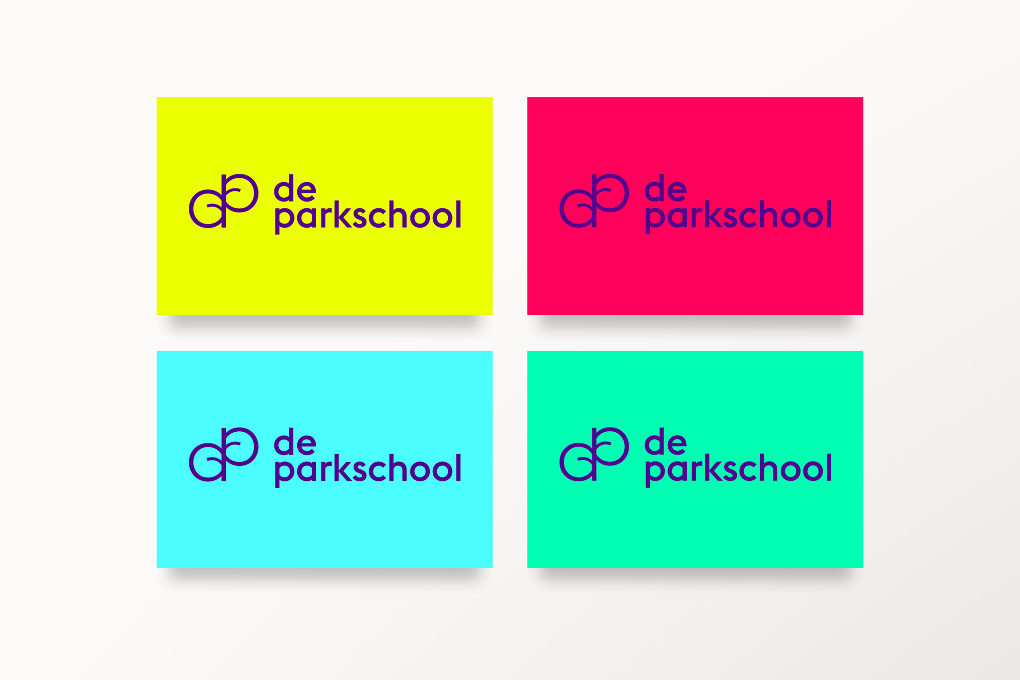 business cards in different colors with De Parkschool logo